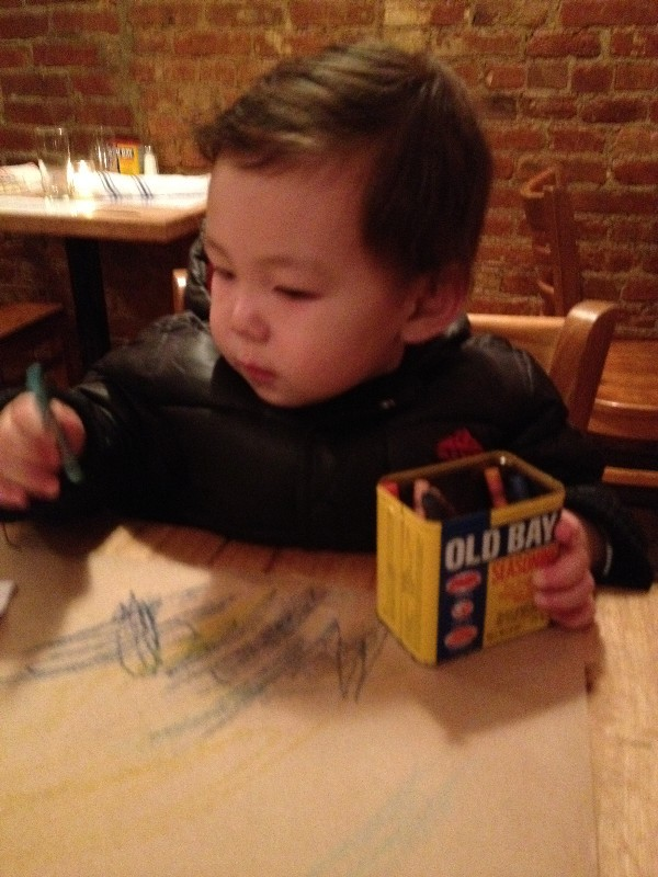 Charlie inspecting his crayon masterpiece